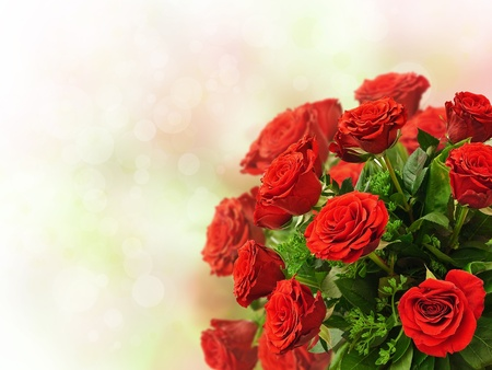 red roses bouquet over the colorful bokeh background photo