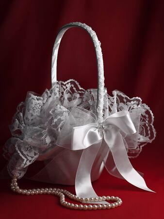 flower basket: Bridal flower basket and pearl beads over the red