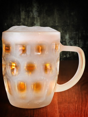cold amber beer in a frozen mug Stock Photo - 8847377