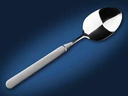 soup spoon: cucchiaio di minestra singolo su sfondo blu