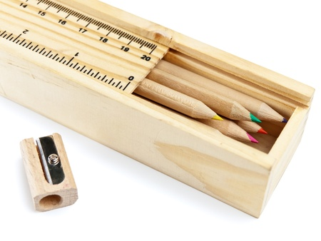 pencil case: wooden pencil case with colour pencils on white background