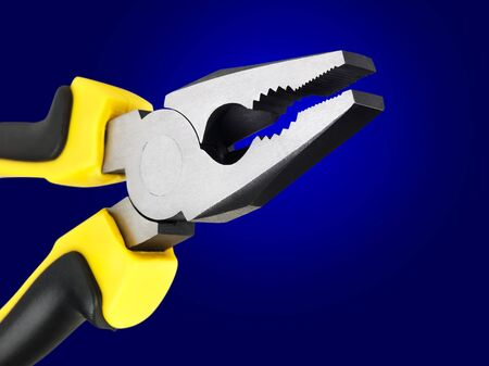 flatnose: flat-nose pliers over the blue background Stock Photo