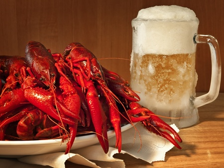 red boiled crawfishes on plate and beer  photo