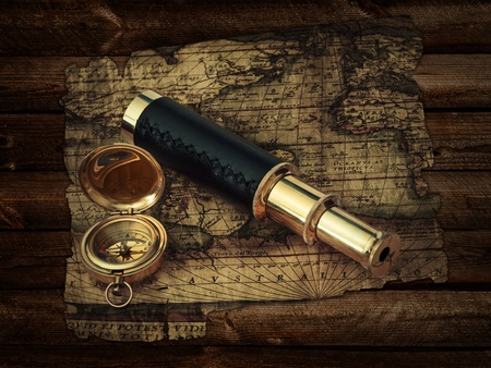 traveling theme: vintage telescope and compass at antique (17 century) map at wooden background 스톡 사진