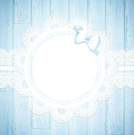 lacework: lace round frame with bow at blue wooden background