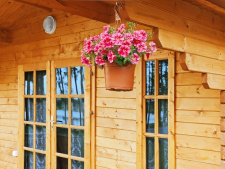 dangling: flower pot dangling from the roof of the house Stock Photo