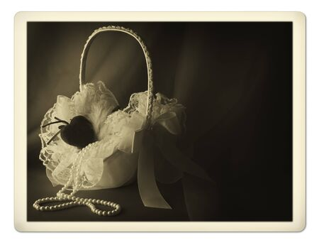 flower basket: Old photo of bridal flower basket with pearl neklace