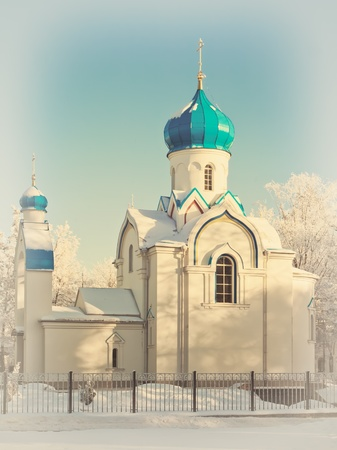 god box: church in winter scenery with white snow and blue sky Stock Photo
