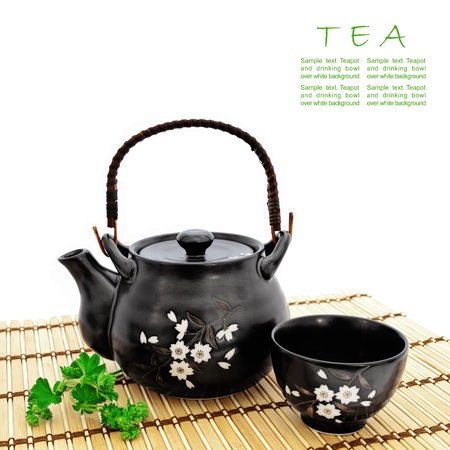 chinese tea pot: chinese tea ceremony at bamboo mat over white, copyspace for your text