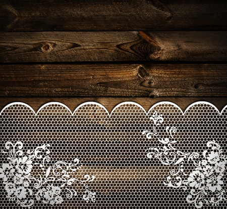 embroidery on fabric: wooden background with white lace frame