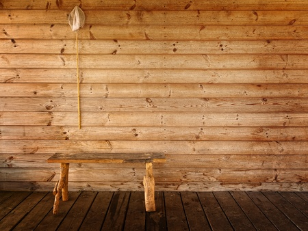 butterfly net and bench against wooden wall photo