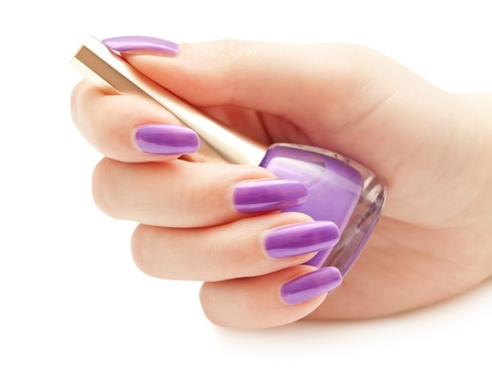 cosmetic lacquer: Nail polish in the woman hand over white Stock Photo