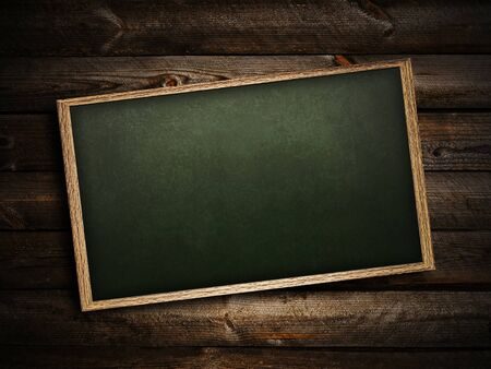 timber frame: School blackboard at abstract dark wooden background   Stock Photo