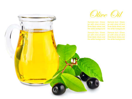 healthful: Olive oil and olives with green leaves against white background Stock Photo