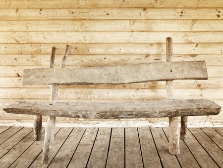 old wooden bench against wooden wall photo