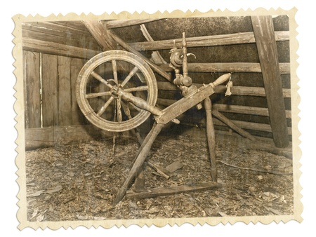 handcrafted: old photo of spinning wheel on a white background Stock Photo