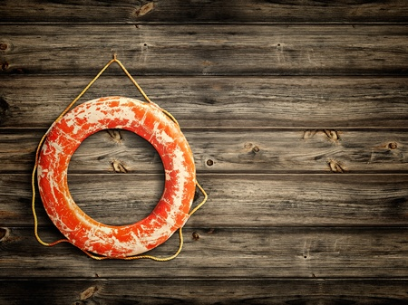 lifebuoy at wooden background, copyspace for your text Foto de archivo
