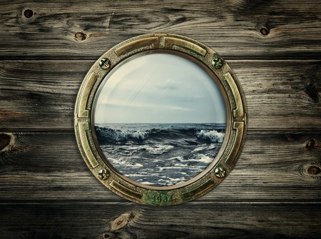 ship porthole: porthole with view at the sea