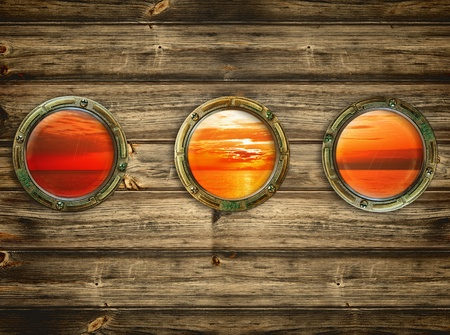 three portholes with view at the sunrise