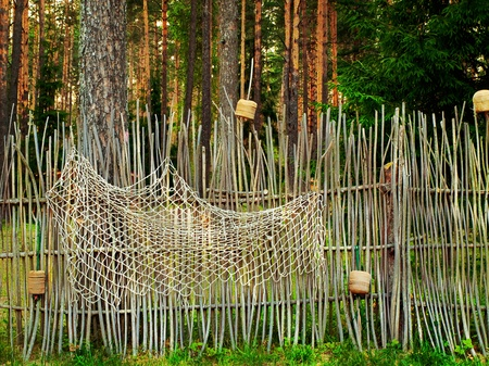 palisade: handmade fence with fishing net in the forest