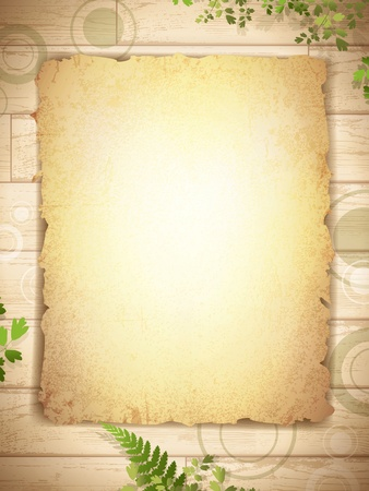 burnt edges: vintage grunge burnt paper at wooden background with floral decoration
