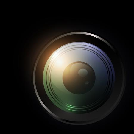 검정 배경 위에 카메라 렌즈의 그림