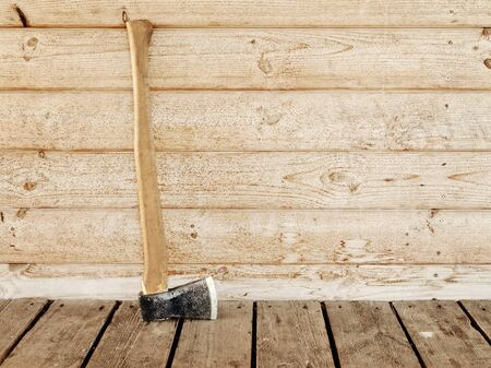 Ņhatchet: single old hatchet near the wooden wall