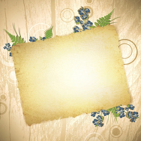 forget me not: vintage grunge burnt paper at wooden background with floral decoration