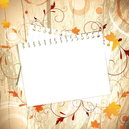 yellow notebook: Template at wooden background over maple red and yellow leaves, copyspace for your text