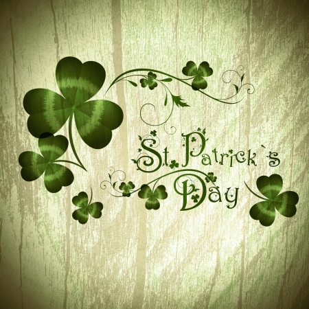 st patricks day: Vintage wooden background with St.Patrick day greeting with shamrocks
