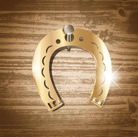 golden horseshoe: Single golden horseshoe over wooden background