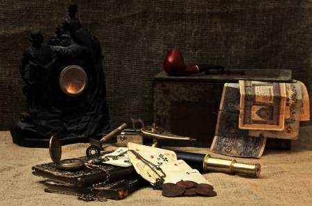 old items: Still life in candle light with old things Stock Photo