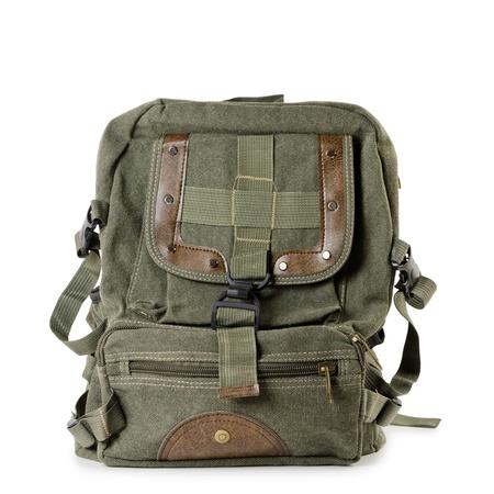 backpack: Mochila de lona vieja sobre el fondo blanco
