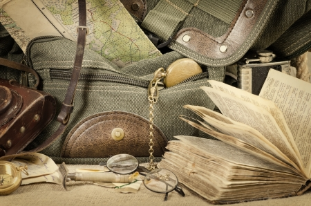 photo of accessories: Still life with an old backpack and travel accessories Stock Photo