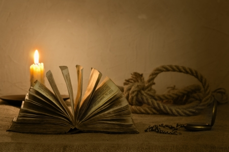 christian candle: Old Bible  19th century , clock and loop by candlelight on canvas