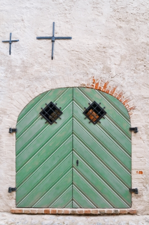 green door: Old Green Wooden Gate In The Wall Stock Photo