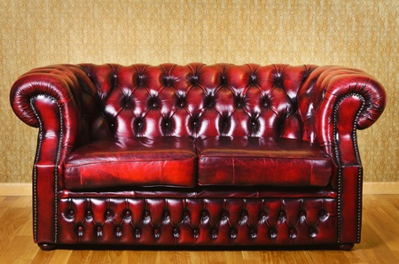 Red Genuine Leather Sofa Near The Wall photo