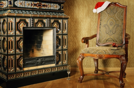 chimney corner: Old Antiques Armchair With Santas Hat Near The Fireplace Stock Photo