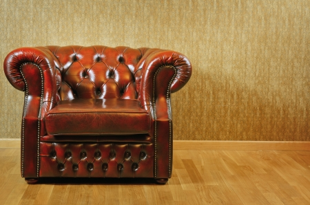 easy chair: Single Old Antique Armchair Near The Wall