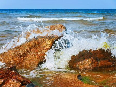 breaking wave: Waves Breaking On Rocks At The Sea Shore