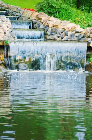 Small Water Cascade In The City Garden photo