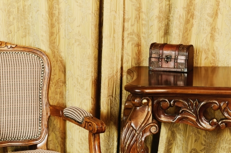 easy chair: Fragment Of The Interior With Antique Furniture And Coffret On The Table Stock Photo