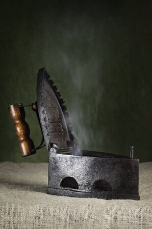 old items: Open Hot Retro Iron On The Canvas Stock Photo