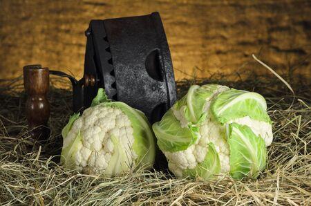 head of cauliflower: Still Life Of Cauliflower Heads And Iron