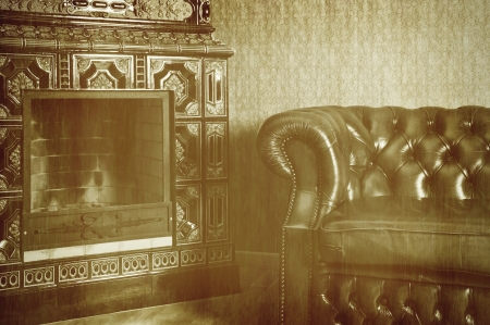 An Old Photo Of The Apartment With Chair And Fireplace photo