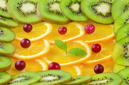 viands: Background From Sliced Fruits, Red Bilberry And Mint Stock Photo