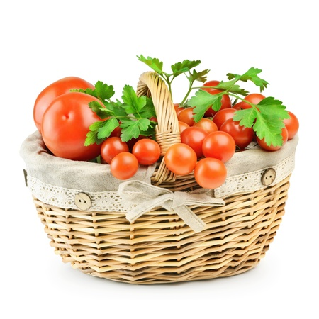 Basket With A Crop Of Tomatoes On A White Background photo