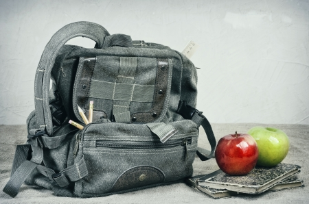 bookbag: Still Life With An Old Backpack, Books And Apples