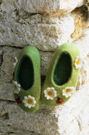 houseshoe: Soft Felted Slippers Hanging On The Wall