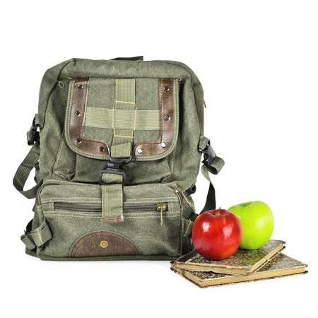 packsack: Old Backpack, Apples And Books Over The White Stock Photo